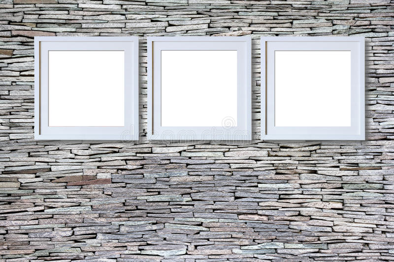 Blank frames on stone wall stock images