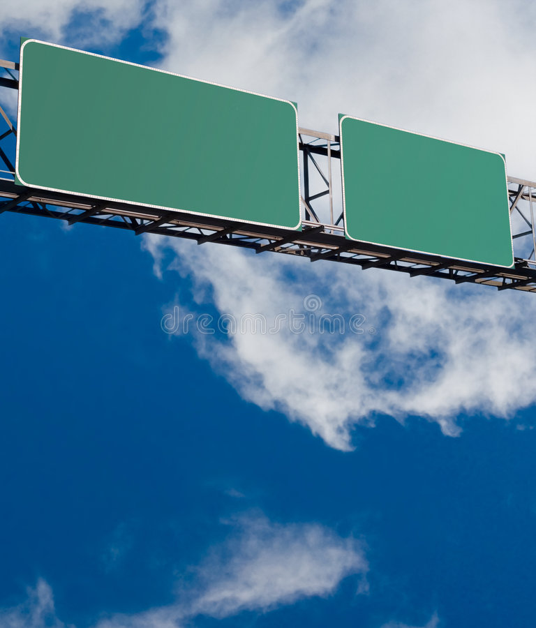 Blank freeway sign. With blue cloudy sky in background royalty free stock photo