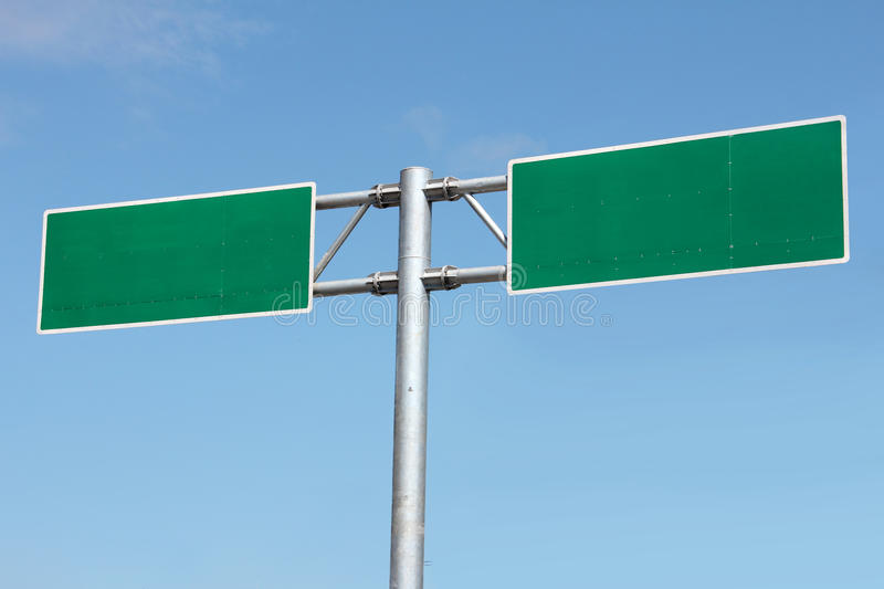 Blank freeway sign ready for your custom text. Under blue sky stock images