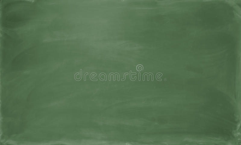 Blank green chalkboard. Background and texture. stock image
