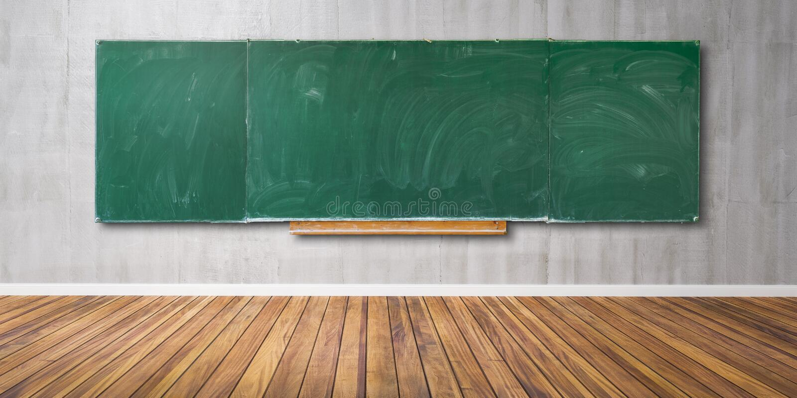 Blank green chalkboard, blackboard texture with copy space hangs on gray grunge wall and wooden floor 3D-Illustration royalty free stock photo