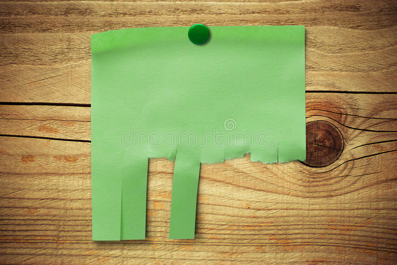Blank green note with tearable strips