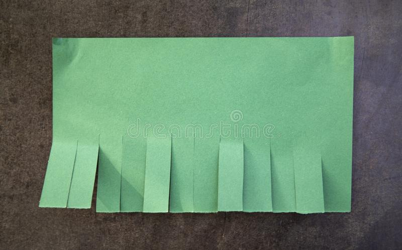 Blank green paper. With tear off tabs stock photos