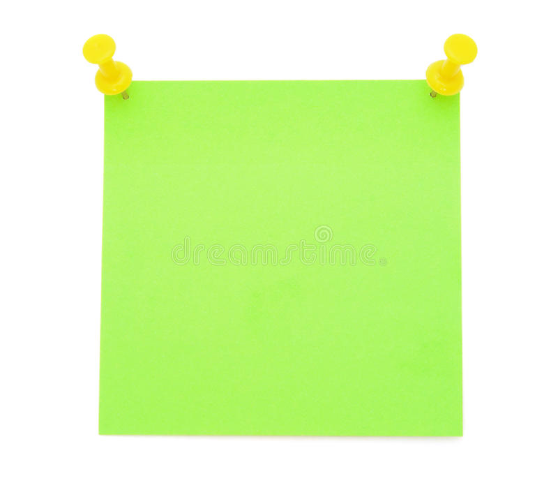 Blank green post-it note. With yellow pushpins isolated on white background royalty free stock image