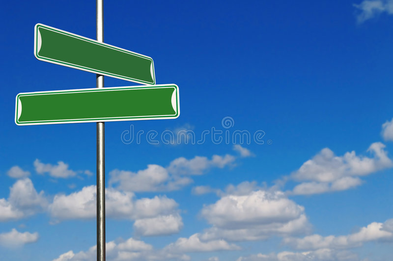 Download Blank Green Street Name Signs Agains A Bright Blue Stock Photo - Image: 7637122