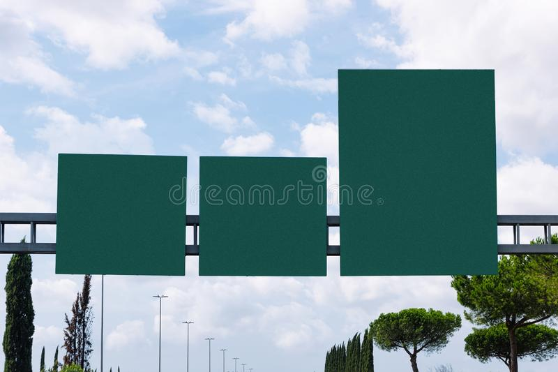 Blank green traffic signs on the road. In Italy stock photography