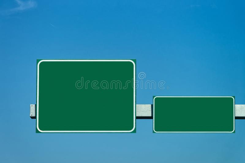 Blank green traffic signs in road stock images