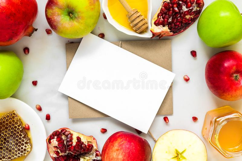 Blank greeting card in frame made of honey, apple and pomegranate. food for Jewish New Year, Rosh Hashanah royalty free stock photos