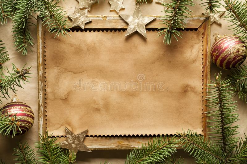 Blank paper sheet in picture frame and spruce tree royalty free stock image