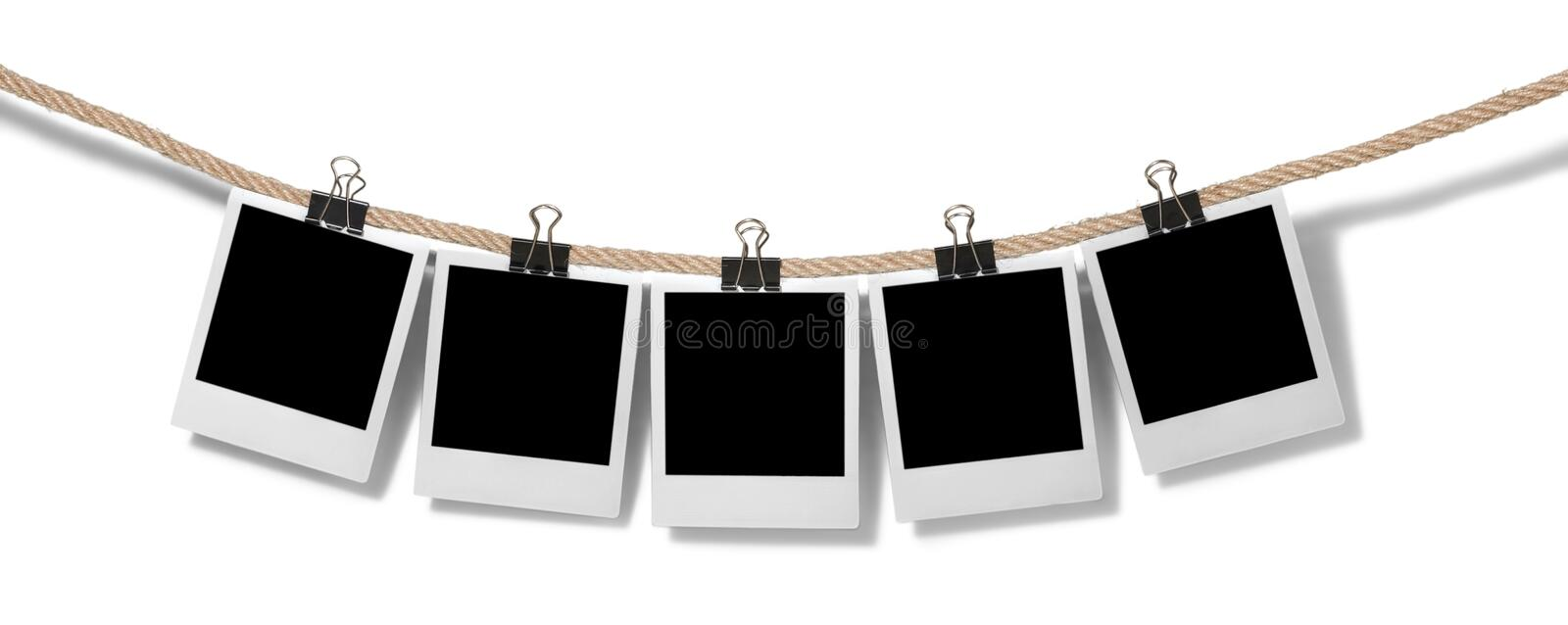 Blank instant photos hanging on the clothesline stock images