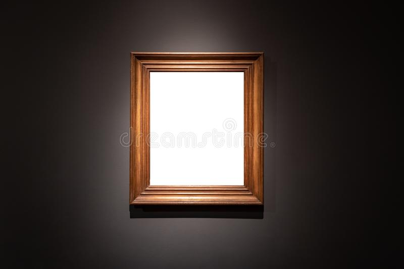 Blank hanging individual frame in an art gallery black background stock photography