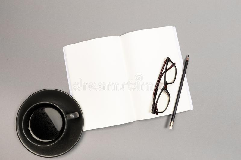 Blank Hard Cover Of Magazine, Book, Booklet, Brochure with coffee cup pencil and glasses. Mock Up Template Ready For Your Design royalty free stock photography
