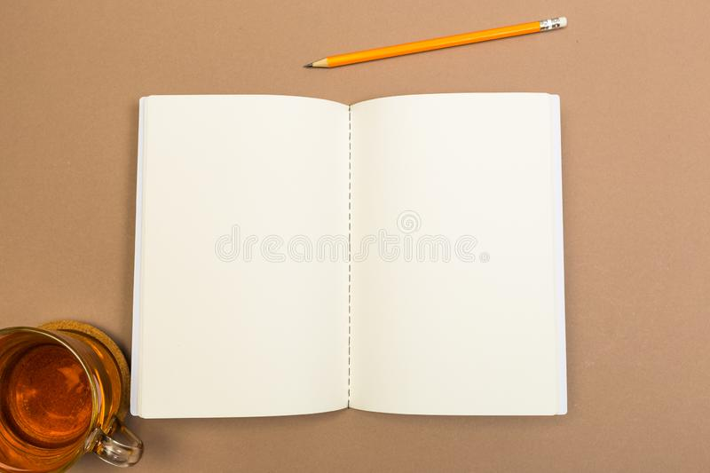 Blank Hard Cover Of Magazine, Book, Booklet, Brochure with pencil and tea cup . Mock Up Template Ready For Your Design royalty free stock photography