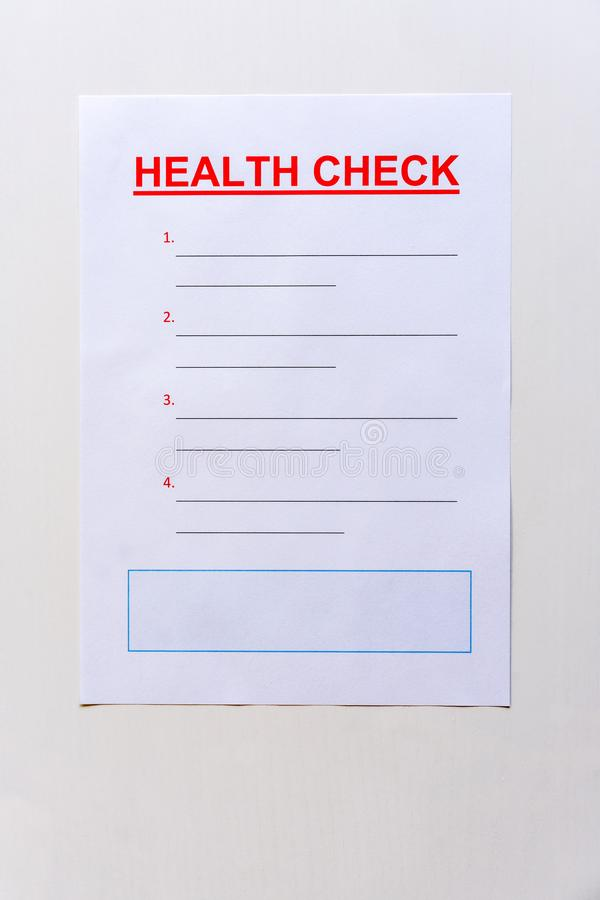 A blank health check form with text and lined copy space. Front view royalty free stock image
