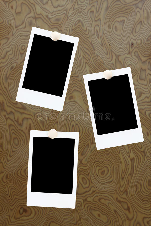 Blank instant photo frames on wooden board vector illustration