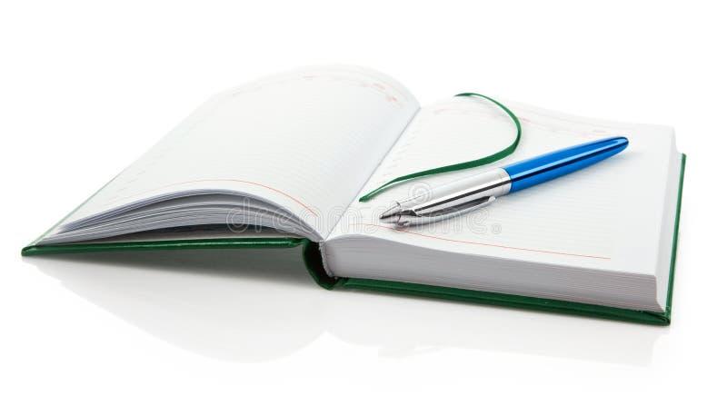 blank isolerad anteckningsbokpennwhite royaltyfri bild