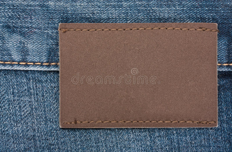 Blank jeans label. Sewed on a blue jeans stock image