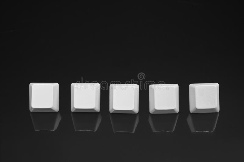 Blank keyboard buttons. Five blank keyboard buttons for placement of any kind of five letter text message royalty free stock images