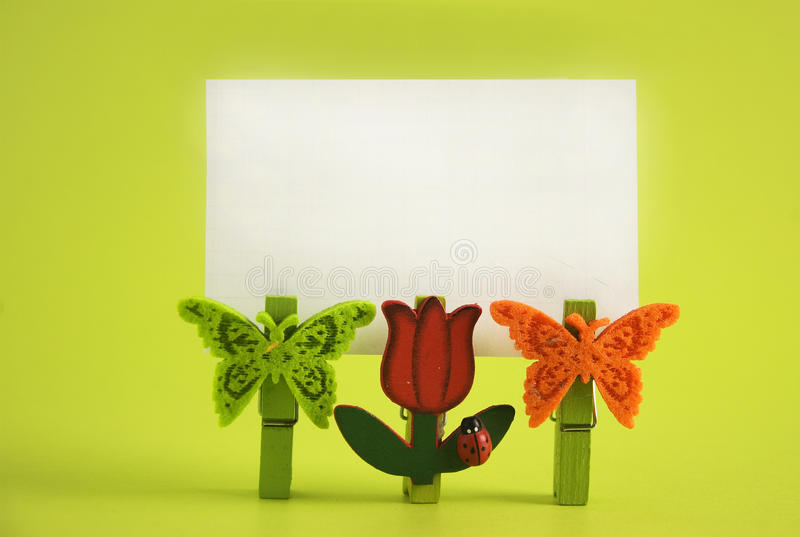 Blank label. With childish clips on a green background royalty free stock images