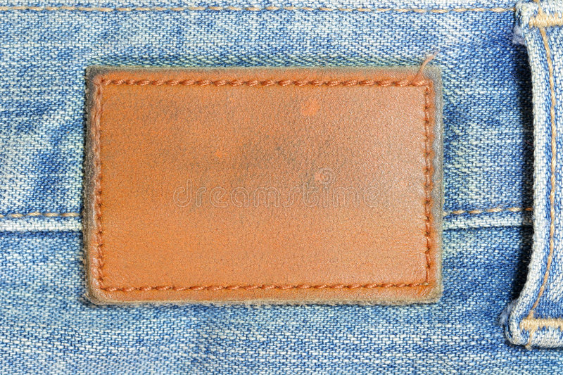 Blank lather label. On blue jeans royalty free stock images