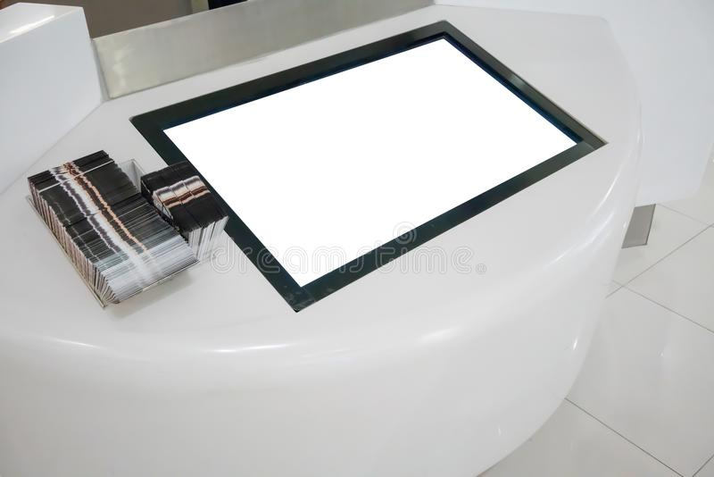 Blank LCD Screen display mock up banner in department store. Blank LCD Screen display mock up banner on white counter in department store royalty free stock image