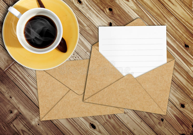 Blank letter with the envelope on coffee table. Blank letter with the envelope on a coffee table royalty free stock photos