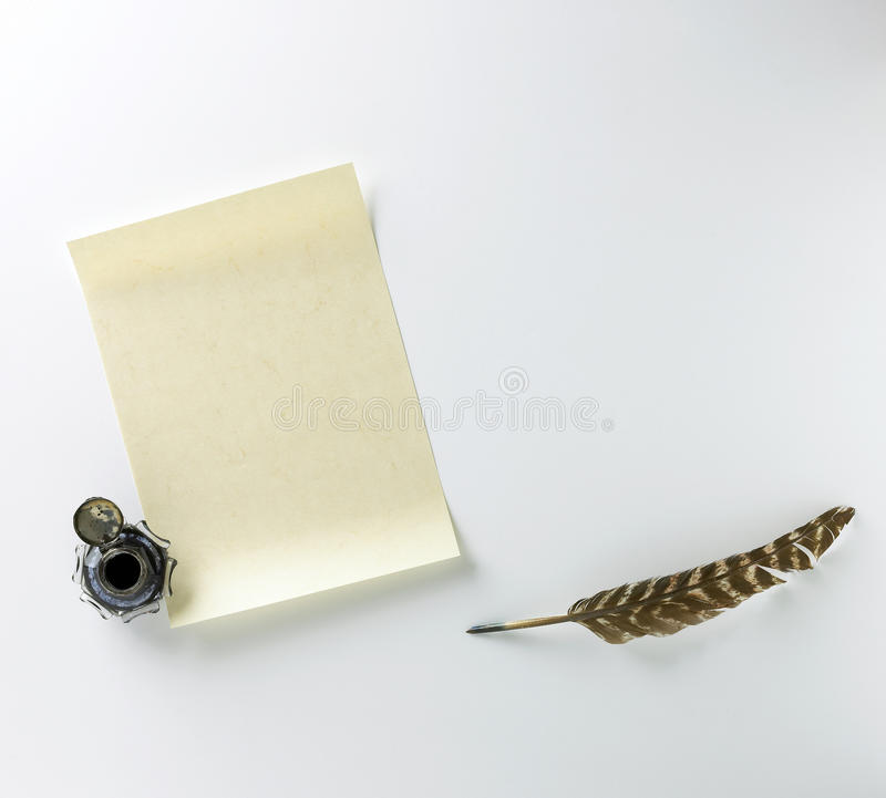 Blank letter, ink and feather quill on a white bac royalty free stock photos