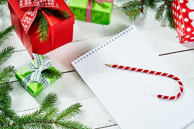 Blank letter to santa and a pencil on an white wooden table with christmas decorations. Blank letter to santa and a pencil on an old white wooden table with royalty free stock photo