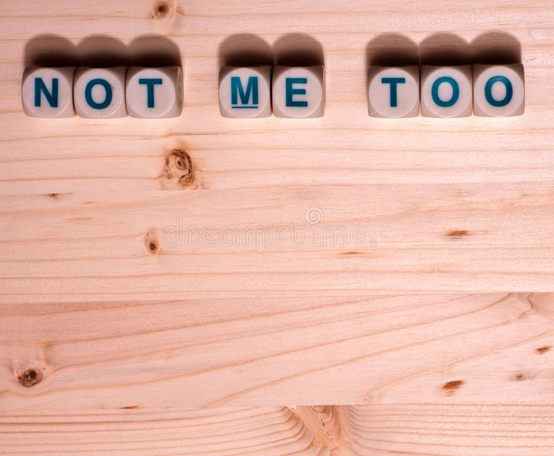 Blank light colored wood fills this template image with the word Not Me Too spelled out in blocks along the top royalty free stock photography