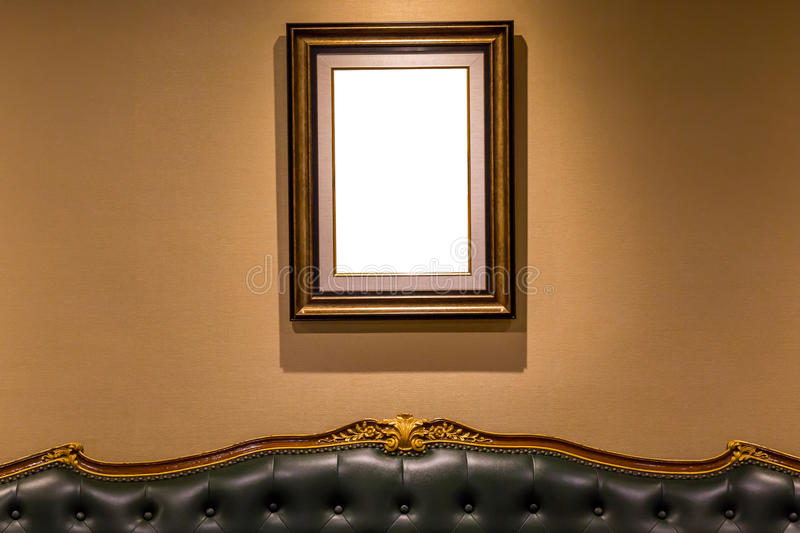 The blank luxury photo frame hanging on wall above the sofa, int. Erior decoration concept stock image