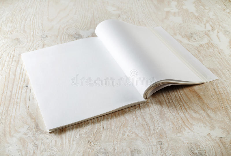 Blank magazine pages. Photo of blank opened magazine with soft shadows on wooden table background. Mock-up for graphic designers portfolios stock photos