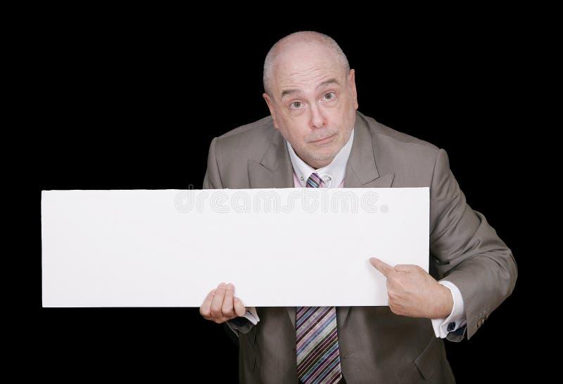 blank man som pekar tecknet till royaltyfria bilder