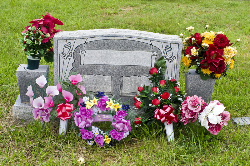 Blank Memorial Stone. Made of granite. Flowers in the vases and in front stock image