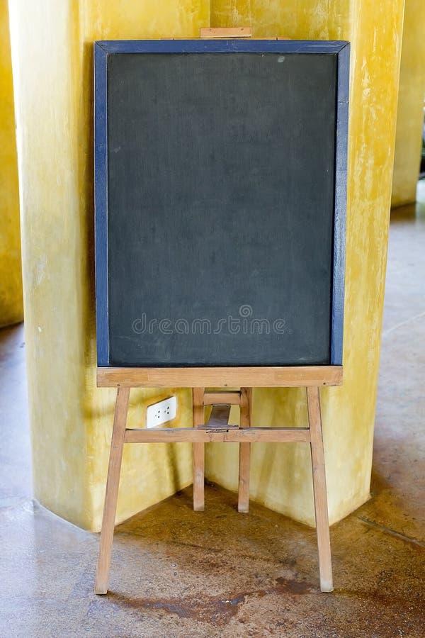 Blank menu chalkboard in wooden frame (Save Paths For design work). Blank menu chalkboard in wooden frame on white background (Save Paths For design work royalty free stock photo