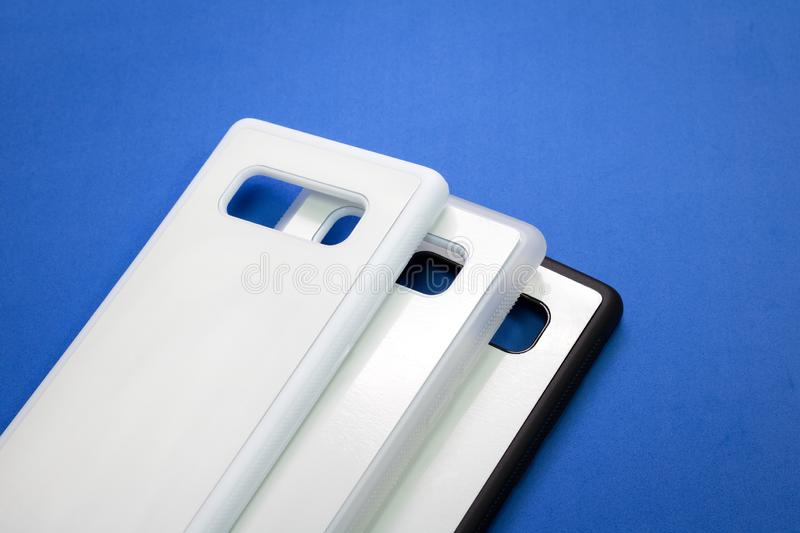 Blank mobile case on blue background. Smart phone cover for your design royalty free stock photo