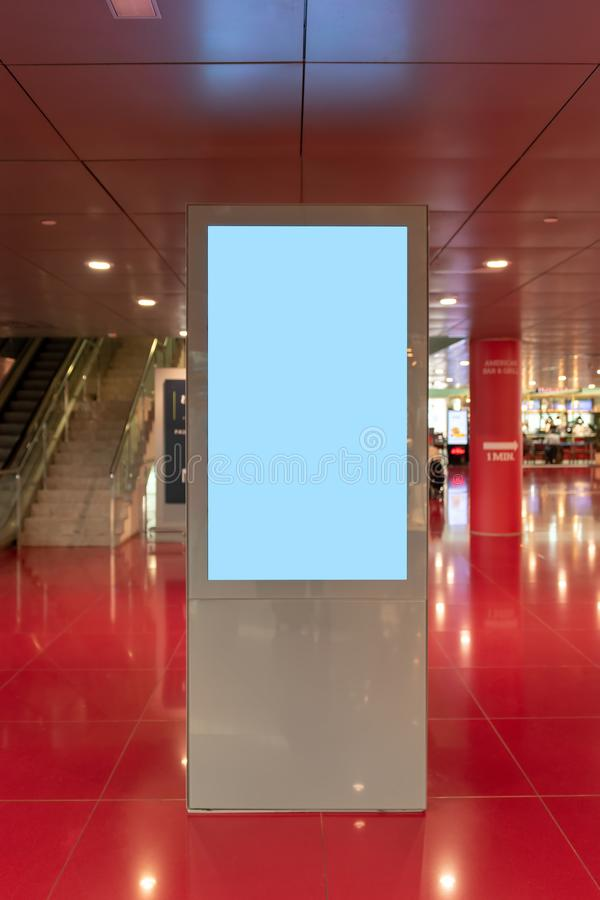 Blank mock up of vertical light box on Airport royalty free stock photo