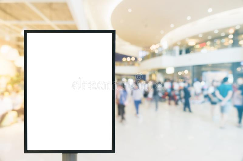 Blank mock up of vertical poster billboard sign with copy space for your text message or content in modern shopping mall. stock photography