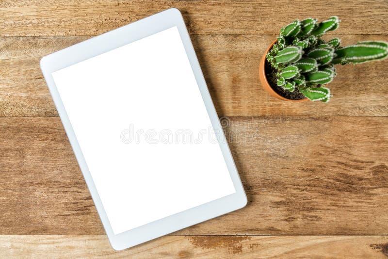Blank modern digital tablet on a wooden desk stock images
