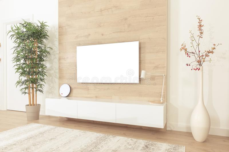 Blank modern flat screen TV hanging on wall in living room stock photo