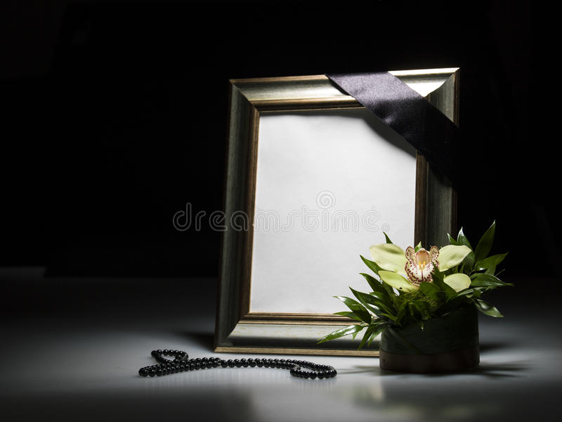Blank mourning frame for sympathy card. On dark background royalty free stock photos