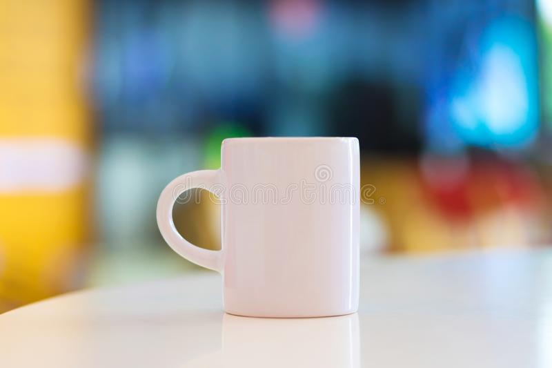 Blank mug on white table background and copyspace. Handle cup or ceramic for your design. Can put your text, image or logo stock image
