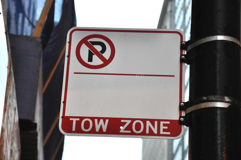 Blank No Parking Tow Zone Sign. A white and red blank space no parking tow zone street sign royalty free stock images