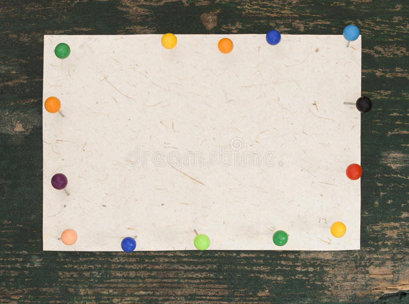 Blank note with colorful pins stock image