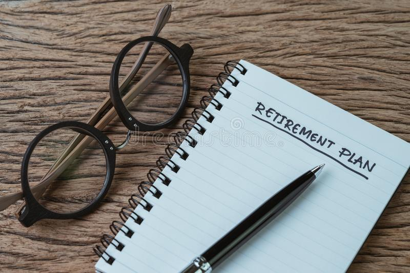 Blank note pad with pen and handwriting headline as Retirement P royalty free stock photography