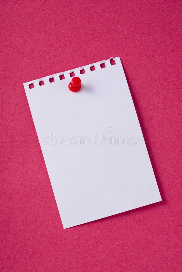 Blank note paper with pin. Blank note paper torn from pad and pinned on a red notice board. See others like this royalty free stock image