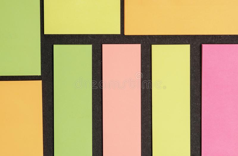 Blank note paper set of different colours forms and sizes. Sticky notes collection on black background.  royalty free stock photography