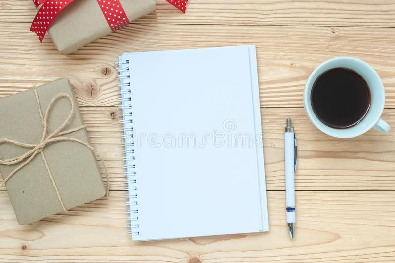 blank notebook, black coffee cup and pen on wooden table, Top view and copy space. Christmas, Happy New Year New Start, Goals, Res royalty free stock image
