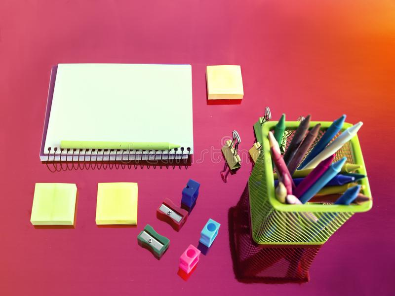 Blank notebook and container with multicolored pencils. Fashion background with school supplies and notebook royalty free stock images