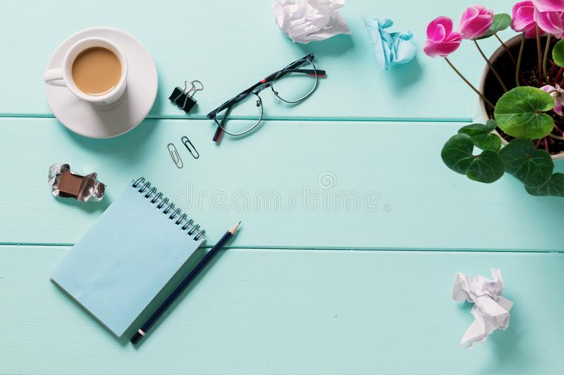 Blank notebook glasses with flower, Top view royalty free stock photos