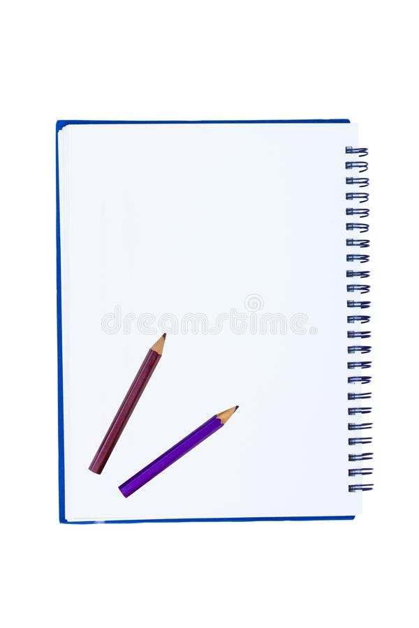 Blank notebook with metal spiral and two crayons. Isolated on white background stock illustration